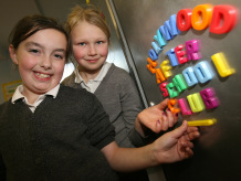 2 girls with magnet letters showing Holywood After Schools Club